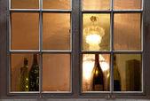 Window with wine bottles — Stock Photo