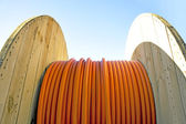 Cable drum with orange cable — Stock Photo