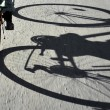 Shadow of cyclist — Stock Photo