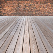 Wooden floor and brick wall — Stock Photo #28028943