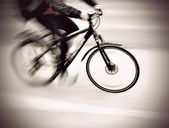 Cyclist in blurred motion — Stock Photo