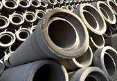 Stack of concrete drainage pipes — Stock Photo