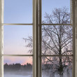 Winter sunset viewed through old window — Stock Photo #32929439