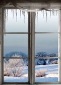 Winter landscape through window — Stock Photo