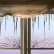 Icicles viewed through window — Stock Photo #33928689