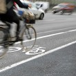 Cyclist in bicycle lane — Stock Photo
