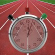 Running tracks with stop watch — Stock Photo