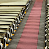 Church pews and aisle in sunshine — Stock Photo