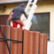 Worker putting new roof tiles on house — Stock Photo