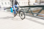 Young man on old bike — Stock Photo