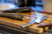 Chopping board with rainbow trout — Stock Photo