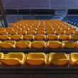 Empty yellow seats at sports stadium — Stock Photo #51312761
