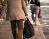 Man in beige clothes on sidewalk — Stock Photo