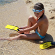 The girl on seacoast. In a mask and flippers  — Stock Photo