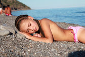 Little cute girl on the beach — Stock Photo