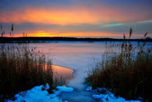 Winter sunset on a frozen lake — Stock Photo