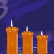 Three yellow candles — Stock Photo