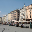 Crowdy main Market Square in Krakow A-B line - Stock Photo