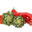 Green artichoke edible sprouts and red peppers  — Stock Photo