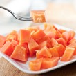 Papaya on white dish — Stock Photo