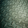 Closeup of metal diamond plate, texture background — Stock Photo #36279437