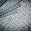 Stock Photo: Closeup of metal sheet and metal diamond plate, texture backgrou