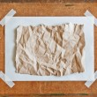 Empty brown Crumpled paper on Particle board background — Stock Photo