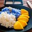 Stock Photo: Thai style dessert, glutinous rice eat with mangoes