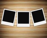 Tree of polaroid photo on wood background — Stock Photo