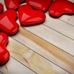 Red heart on wood floor 3d rendering — Stock Photo #37599619