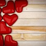 Red heart on wood floor 3d rendering — Stock Photo #37599745