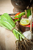 Long coriander leaves and element of tom yum food on chopping bl — Stock Photo