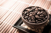 Coffee seed in the wood cup — Stock Photo