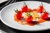 Small tomato and beans on white dish of bio food stylish closeup — Stock Photo