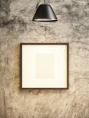 Lamp and frame picture on concrete wall — Foto Stock