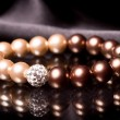 Pearl bracelet over black velvet - Stock Photo
