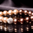 Stock Photo: Pearl bracelet over black velvet
