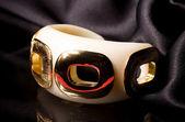 Beautiful golden bracelet on grey background — Stock Photo