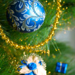 Beautiful painting christmas decorations hanging on christmas tree with shiny glare — ストック写真