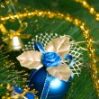 Beautiful blue christmas decorations hanging on christmas tree with shiny glare — Stock Photo