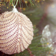 Beautiful  christmas decorations hanging on christmas tree with shiny glare — Stock Photo