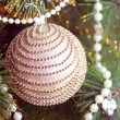 Beautiful christmas decorations hanging on christmas tree with shiny glare — Стоковая фотография