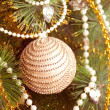 Beautiful christmas decorations hanging on christmas tree with shiny glare — Photo