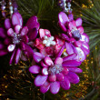 Beautiful necklace on a branch of fir - Stockfoto