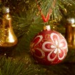 Beautiful color christmas decorations hanging on christmas tree with shiny glare — Foto Stock