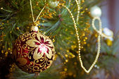 Beautiful color christmas decorations hanging on christmas tree with shiny glare — Stock Photo