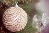 Beautiful christmas decorations hanging on christmas tree with shiny glare — Stock Photo