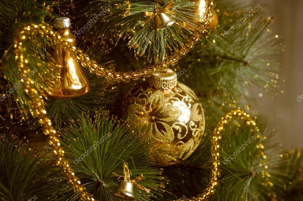 Beautiful Golden Christmas Decorations Hanging On