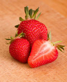 Strawberry on wooden background — Stock Photo