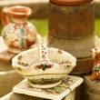 Rustic handmade ceramic clay souvenirs decorated by traditional ornament — Stock Photo #25703875